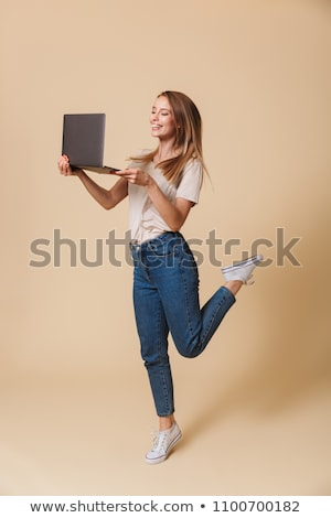 Full length image of european woman 20s smiling and jumping, iso Stock photo © deandrobot