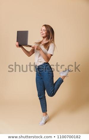 Tam uzunlukta görüntü avrupa kadın 20s gülen Stok fotoğraf © deandrobot