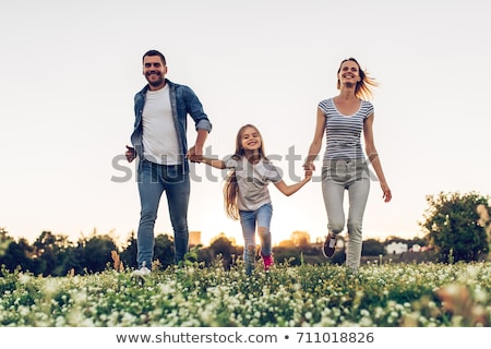 Happy young girl spending time at the park Stock photo © deandrobot