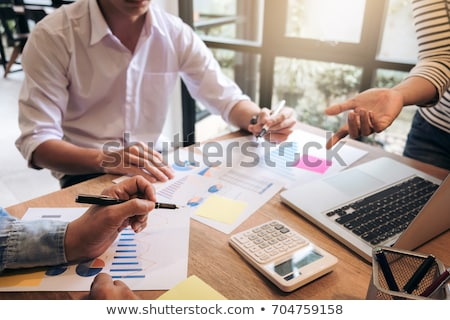 Business adviser analyzing financial with new startup finance pr Stock photo © Freedomz