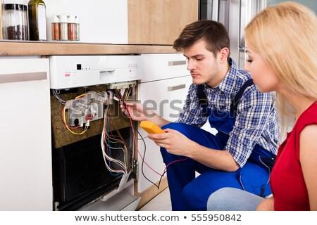 Kettő férfi technikus megjavít háztartási gépek konyha Stock fotó © AndreyPopov