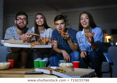 friends with drinks and pizza watching tv at home Stock photo © dolgachov