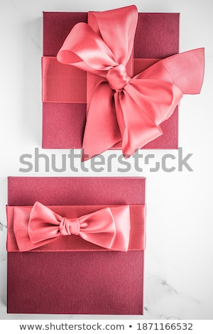 Coral silk ribbon and bow on marble background, girl baby shower Stock photo © Anneleven