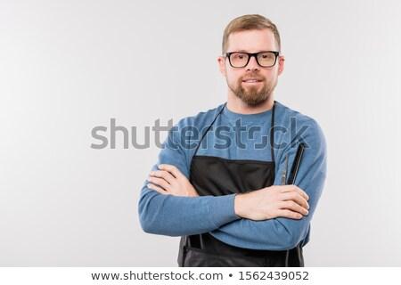 Heureux jeunes barbu salon de coiffure tablier lunettes Photo stock © pressmaster