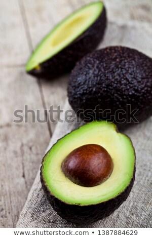 Organic avocado on linen napkin on rustic wooden table backgroun Stock photo © marylooo