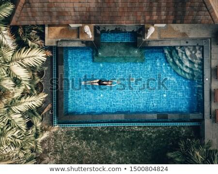 Genç kadın rahatlatıcı çatı üst yüzme havuzu Stok fotoğraf © GVS