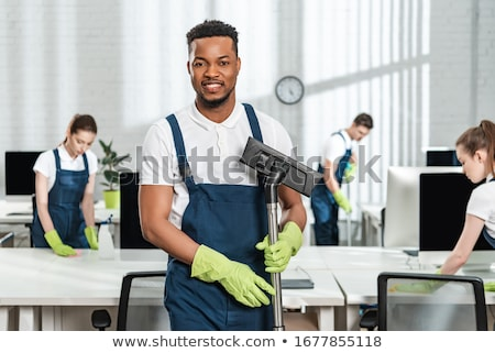 Mulher homem comercial limpador equipe escritório Foto stock © Kzenon