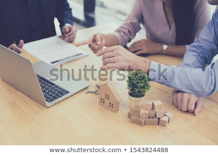 Sale representative offer house purchase contract to buy a house Stock photo © snowing