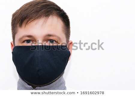 A man wearing a black respiratory mask on his face Stock photo © butenkow