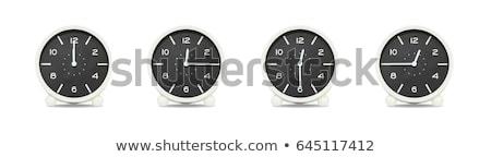 group of alarm clock with times 12 clock stock photo © vladacanon