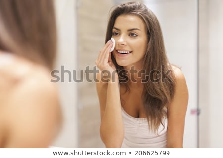 beautiful woman cleaning face stock photo © anna_om