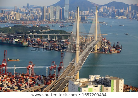 Сток-фото: контейнера · моста · Гонконг · небе · воды · автомобилей