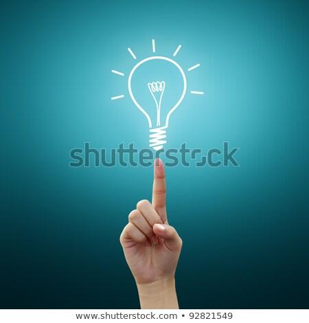 Light Bulb Small On Woman Hand Stok fotoğraf © Sarunyu_foto