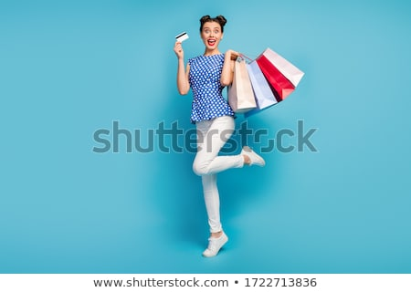 f74692815 pinup retro woman with travel bag isolated Stock photo © dotshock