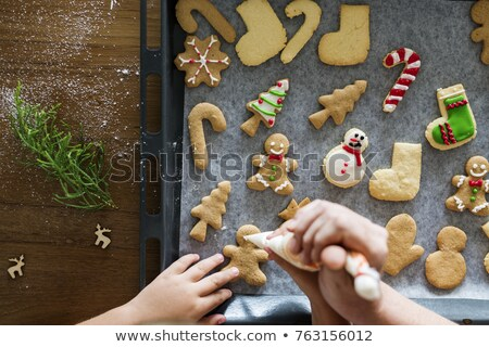 Decorating Christmas cookies Stock photo © IngaNielsen