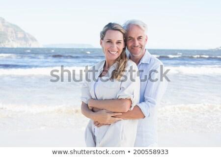 Knap paar water permanente liefde Stockfoto © pkirillov