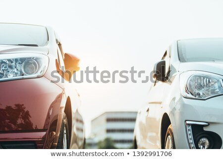 Stock photo: Line up of colorful new cars parked side by side in a row
