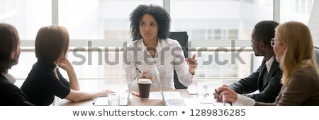 Male executive with female colleague out of focus in the background Stock photo © photography33