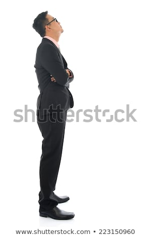 Portrait of mid adult asian man looking up stock photo © diego_cervo
