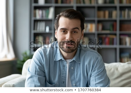 man sitting on the couch with a computer Stock photo © photography33