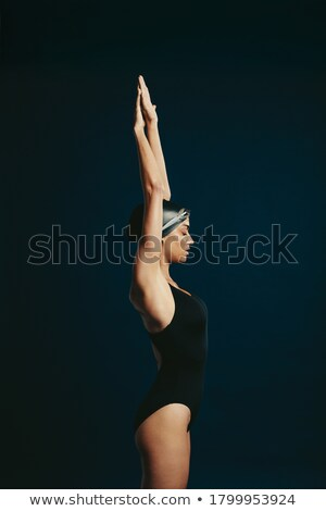 Muscular strong woman posing against a black background Stock photo © Nobilior