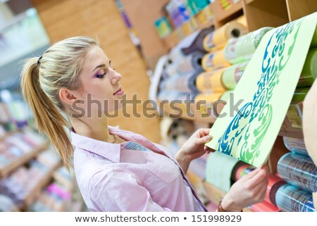 female diy holding rolls of wallpaper Stock photo © photography33