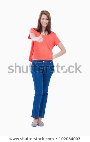 Adolescent standing against a colourless background with one thumb up Stock photo © wavebreak_media