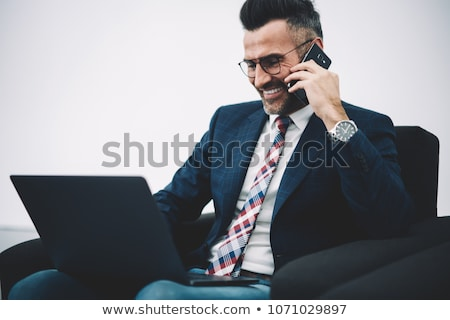 Businessman laughing during telephone call Stock photo © photography33