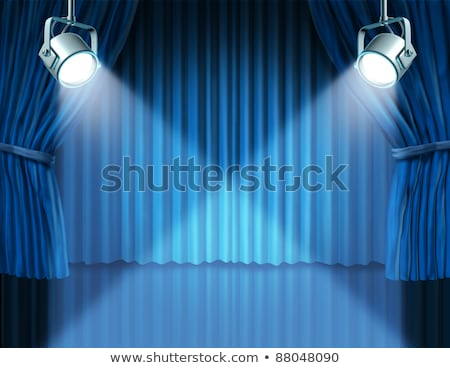 introducing on a blue curtain stage stock photo © lightsource