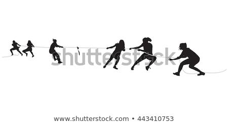 Competitivo empresária jogar guerra corda mulher de negócios Foto stock © diego_cervo