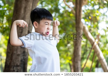 smart boy showing grimaces stock photo © meinzahn