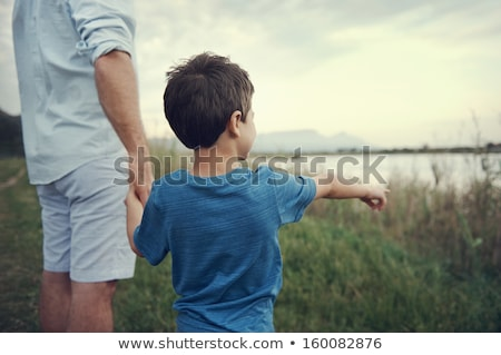 casual man looks away while in grass Stock photo © feedough