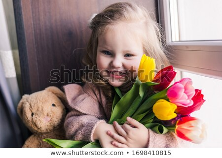 beautiful young girl with tulips and soft toy Stock photo © pandorabox