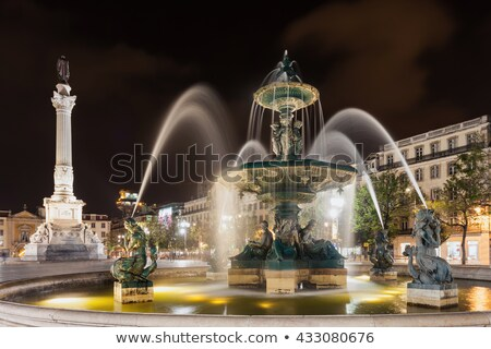 Baroque fountain on rossio square Stock photo © vwalakte
