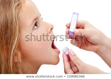 Young girl taking homeopathic medicine Stock photo © ilona75