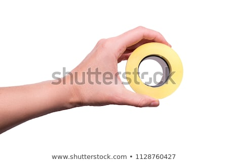 Hand holding roll of adhesive tape Stock photo © Taigi