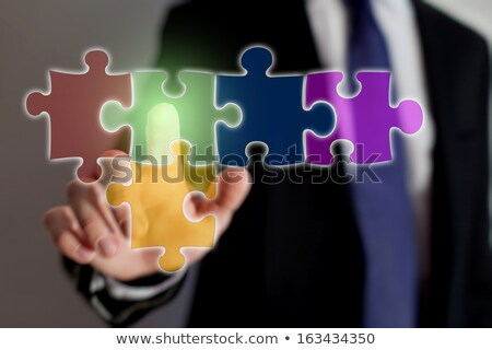 tv set icon on multicolor puzzle stock photo © tashatuvango