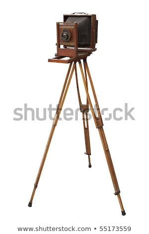 Stock photo: old camera in a tripod