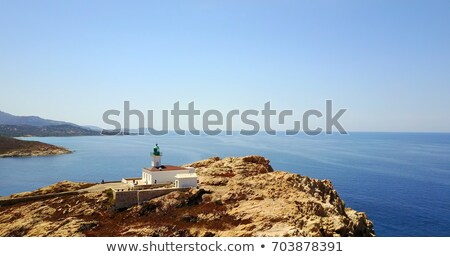 The red rock and lighthouse at Ile Rousse in Corsica Stock photo © Joningall