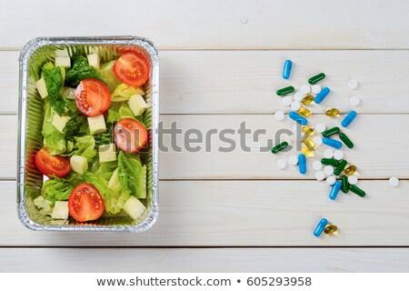 vegetables versus supplement stock photo © spectral