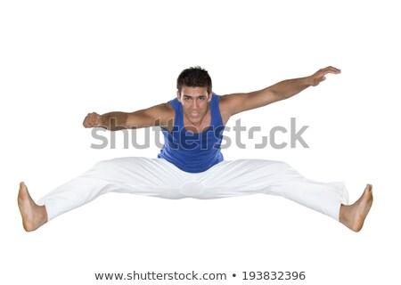 Capoeira férfi ugrik fehér kék sport Stock fotó © BrazilPhoto
