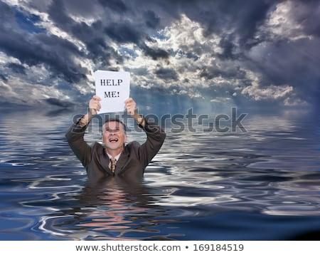 Senior man holding help me paperwork in water Stock photo © backyardproductions