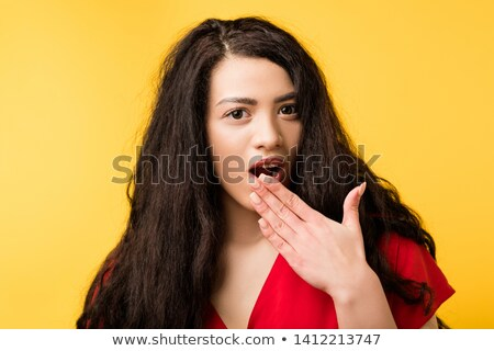 Wow what a surprise for beautiful latino girl in red Stock photo © darrinhenry