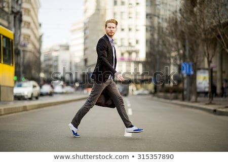 handsome man walking in the city stock photo © feedough
