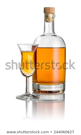 Bottle and high stem glass filled with amber liquid Stock photo © Zerbor