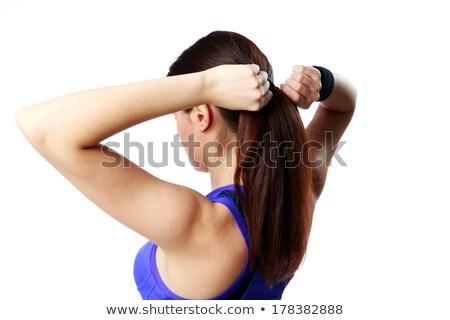 Fiatal fitt nő készít lófarok izolált Stock fotó © deandrobot
