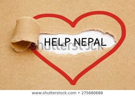 Helpen Nepal gescheurd papier tekst achter gescheurd Stockfoto © ivelin