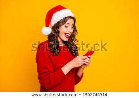 Csinos nő mikulás kalap olvas sms mobiltelefon Stock fotó © juniart