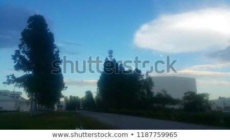 Uncommon building on blue sky with clouds Stock photo © cherezoff