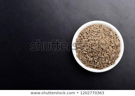 Organiczny kminek nasion ceramiczne puchar biały Zdjęcia stock © ziprashantzi